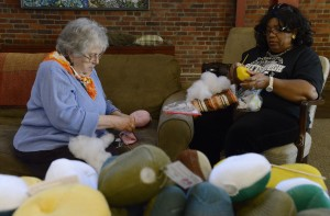 Delli Speers, left, of the South Side, and Deborah Cooper of the North Side make and stuff prosthetic knitted breast implants for the Knitted Knocker Project.