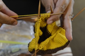 Volunteers make and stuff prosthetic knitted breast implants for the Knitted Knocker Project in the Strip District.