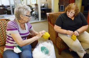 Olga Dubrovsky, left, of Swissvale, and Yvonne Spencer of Hampton, stuff prosthetic knitted breast implants for the Knitted Knocker Project.